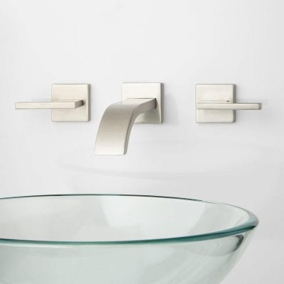 Sleek white panels used can be used in office toilets