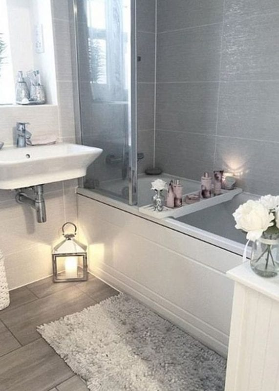 Pale greys around the bath and on the floor